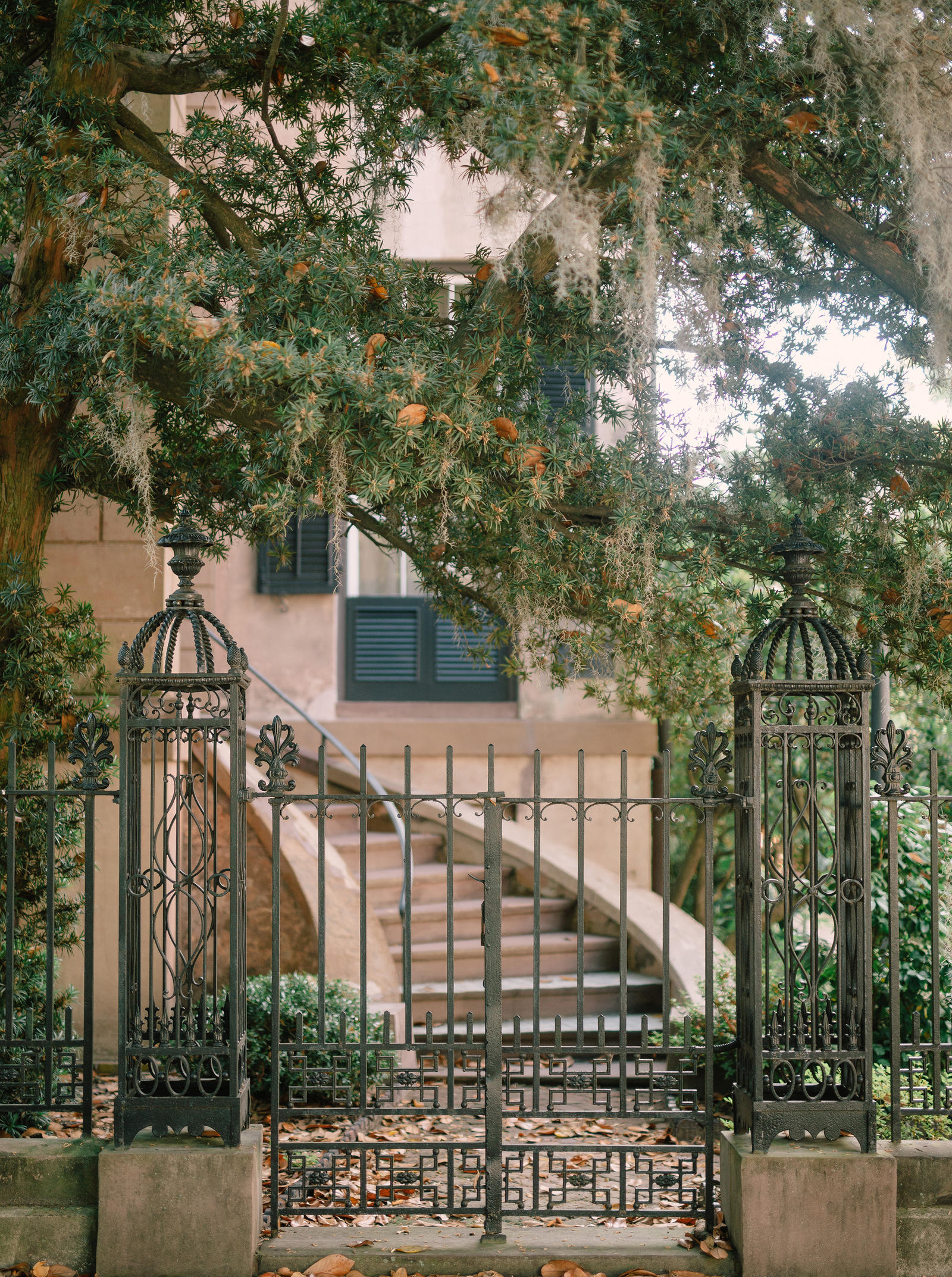 Editorial Photography | Atlanta, GA | An iron gate, in front of a twisting staircase.