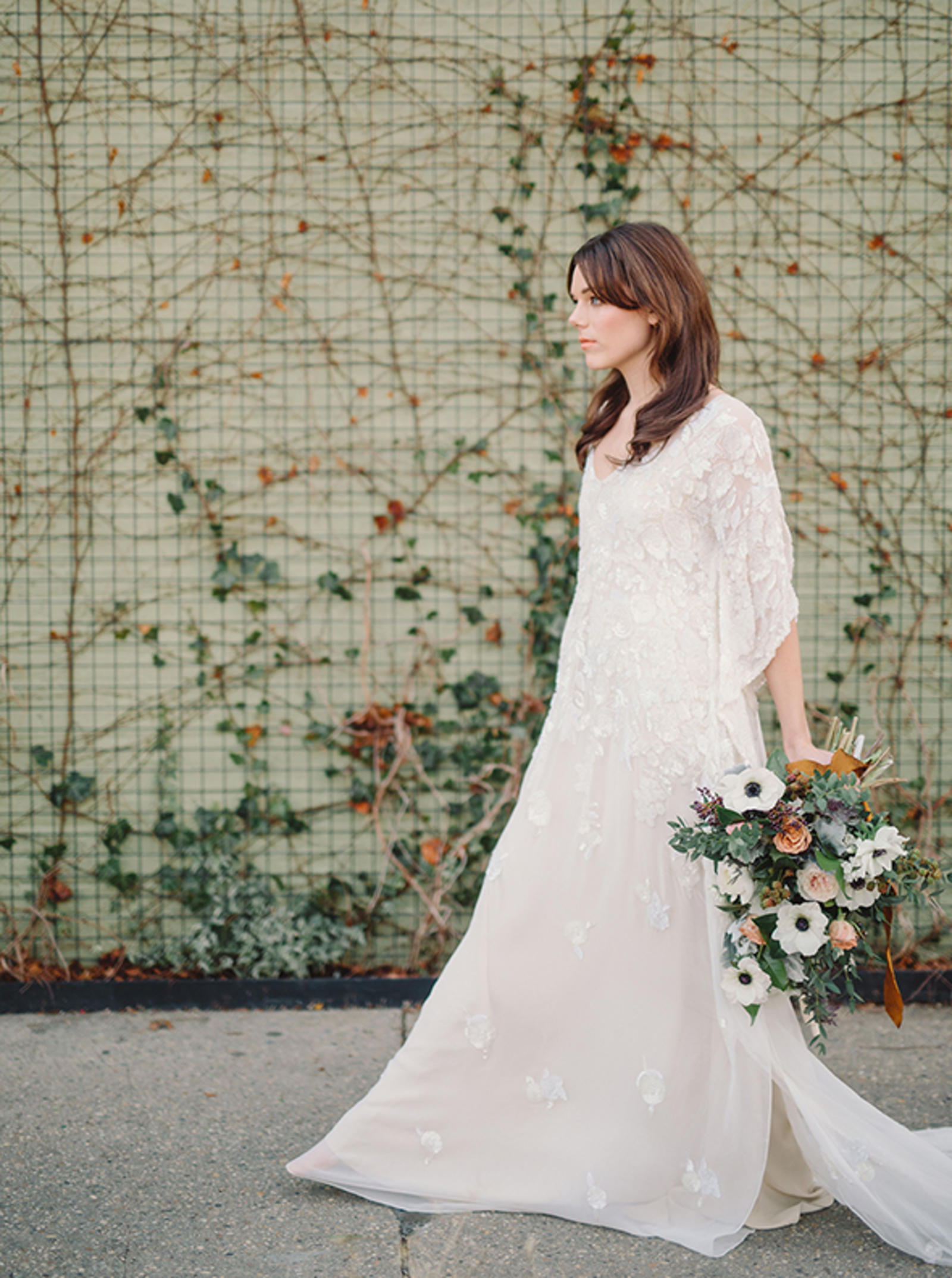 Editorial Photography | Atlanta, GA | A model bride walks, in profile, holding a large floral bouquet.