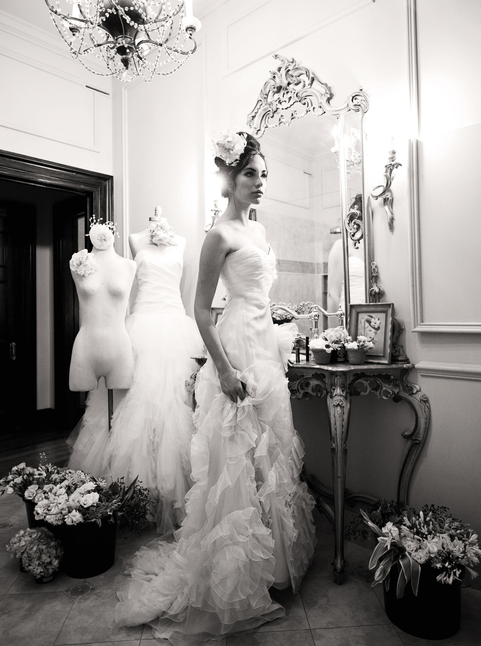 Editorial Photography | Atlanta, GA | A model in an elegant wedding dress stands in front of a vanity.