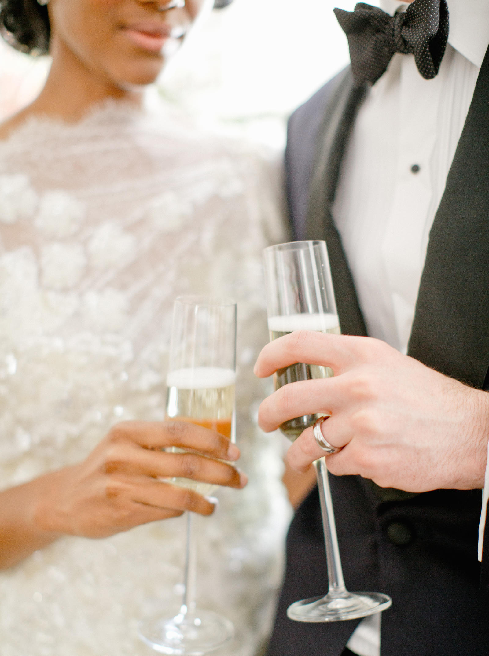 Editorial Photography | Atlanta, GA | A bride and groom holding champagne flutes.