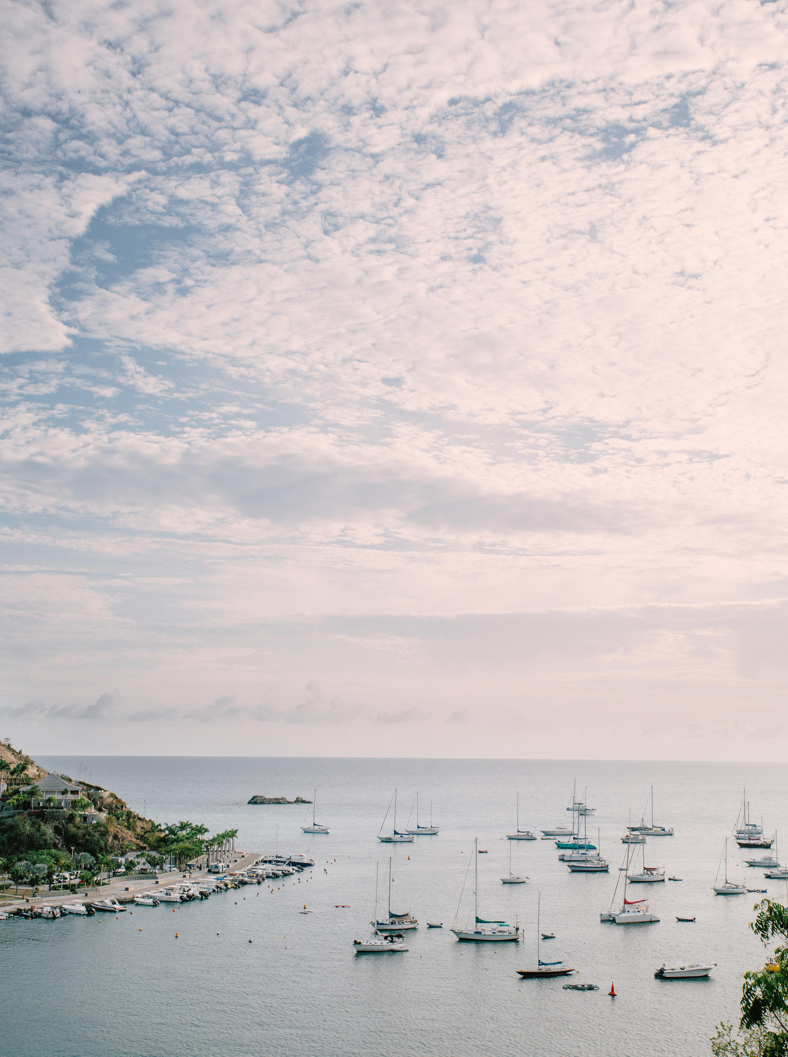 Atlanta Lifestyle Photography | A view of an ocean bay, dotted with sailboats at anchor.