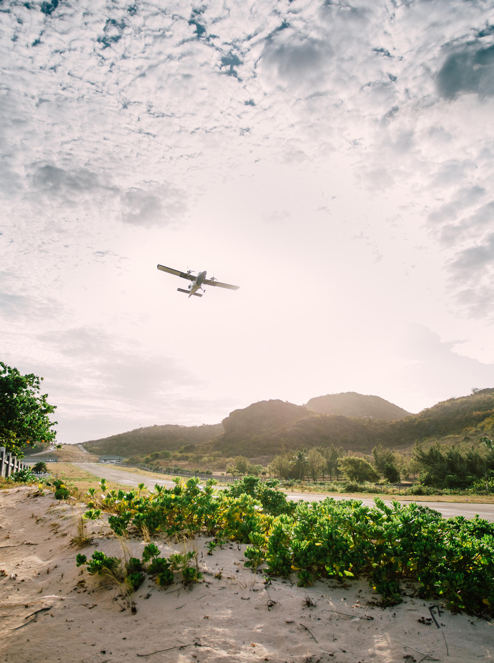 Lifestyle Photography | Atlanta, GA | A small plane takes off from a runway near the beach.