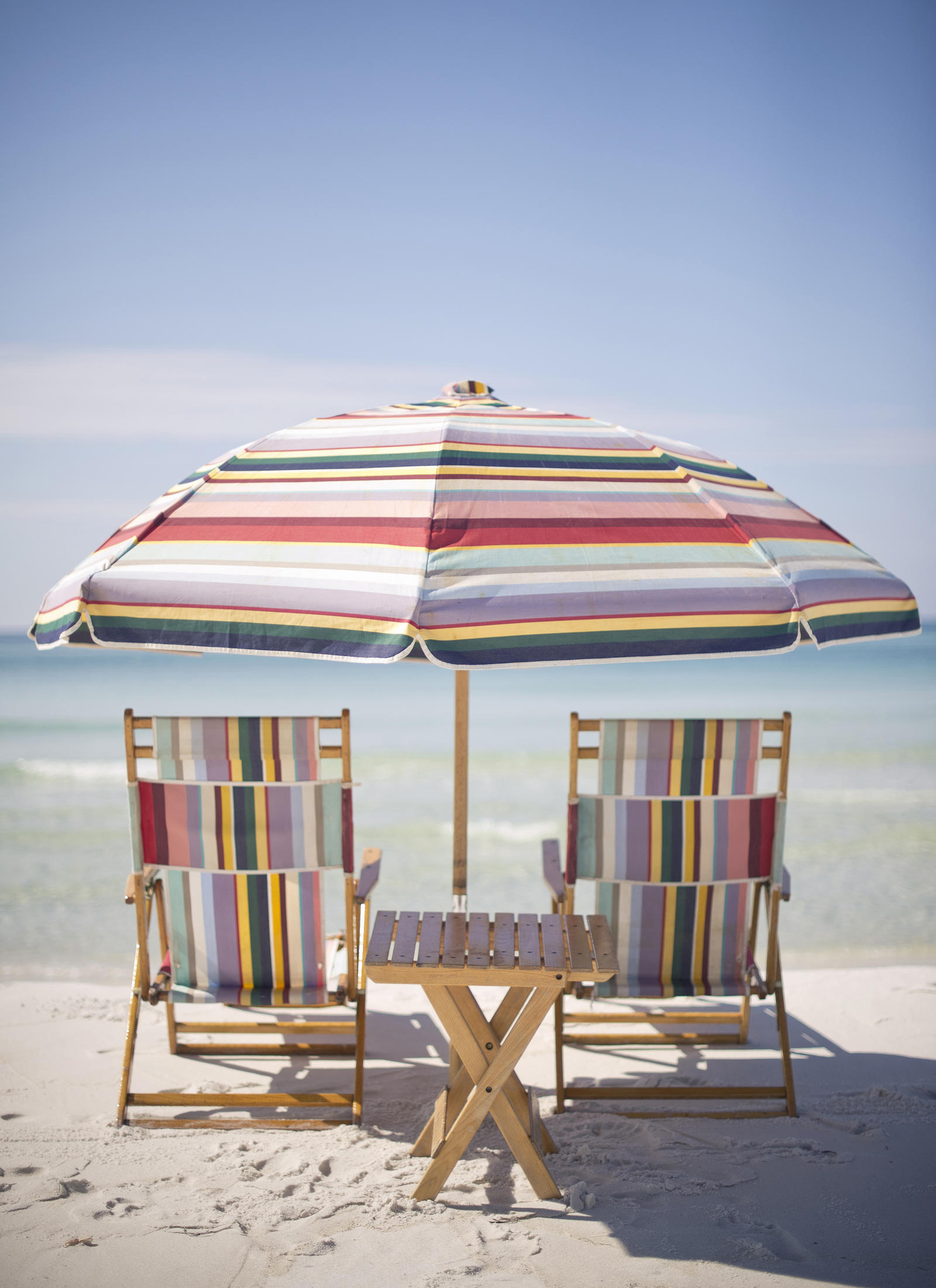 Lifestyle Photography | Atlanta, GA | Two pastel striped beach chairs placed under a pastel striped umbrella.