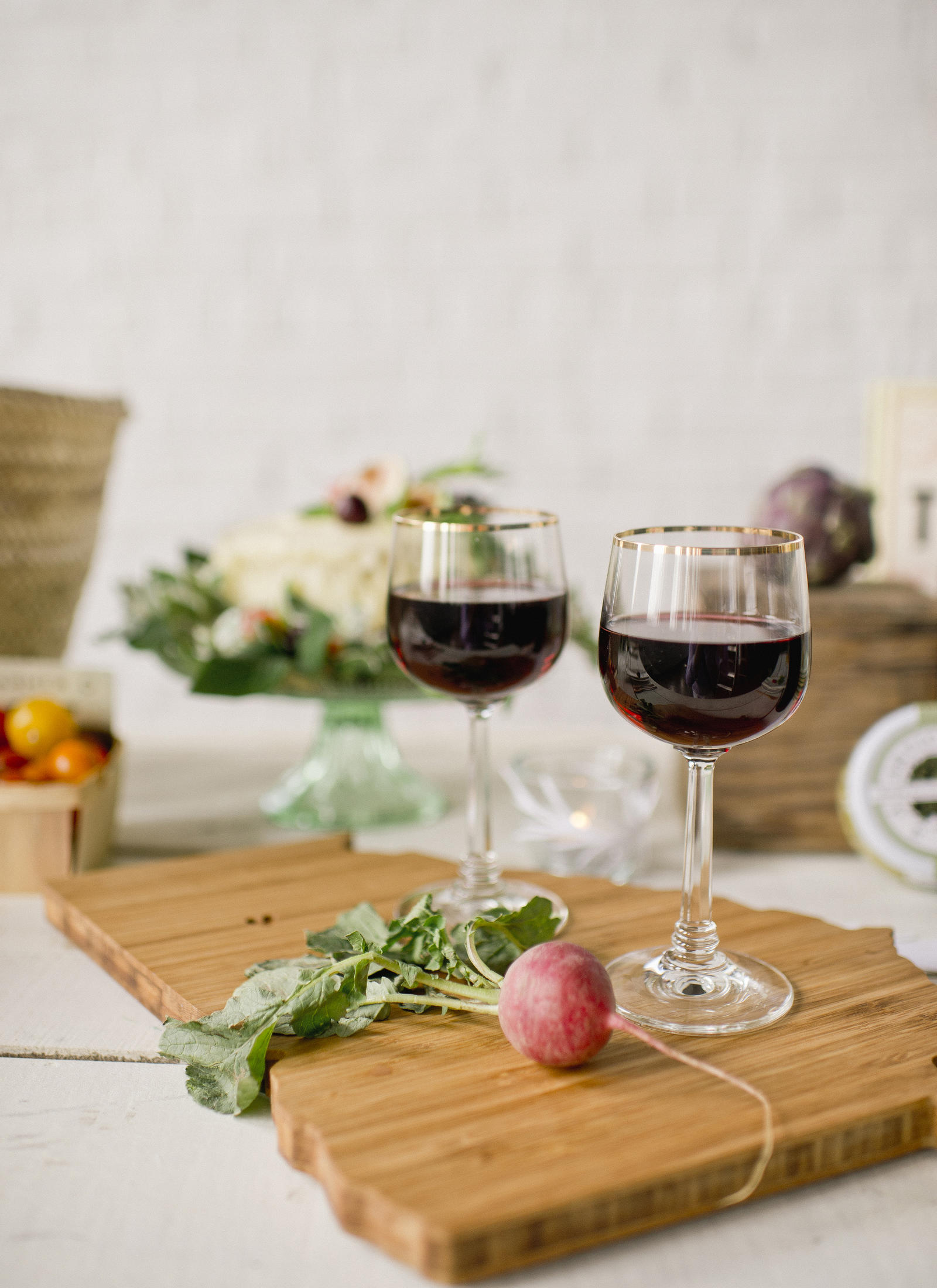 Lifestyle Photography | Atlanta, GA | Two filled wine glasses on a cutting board.