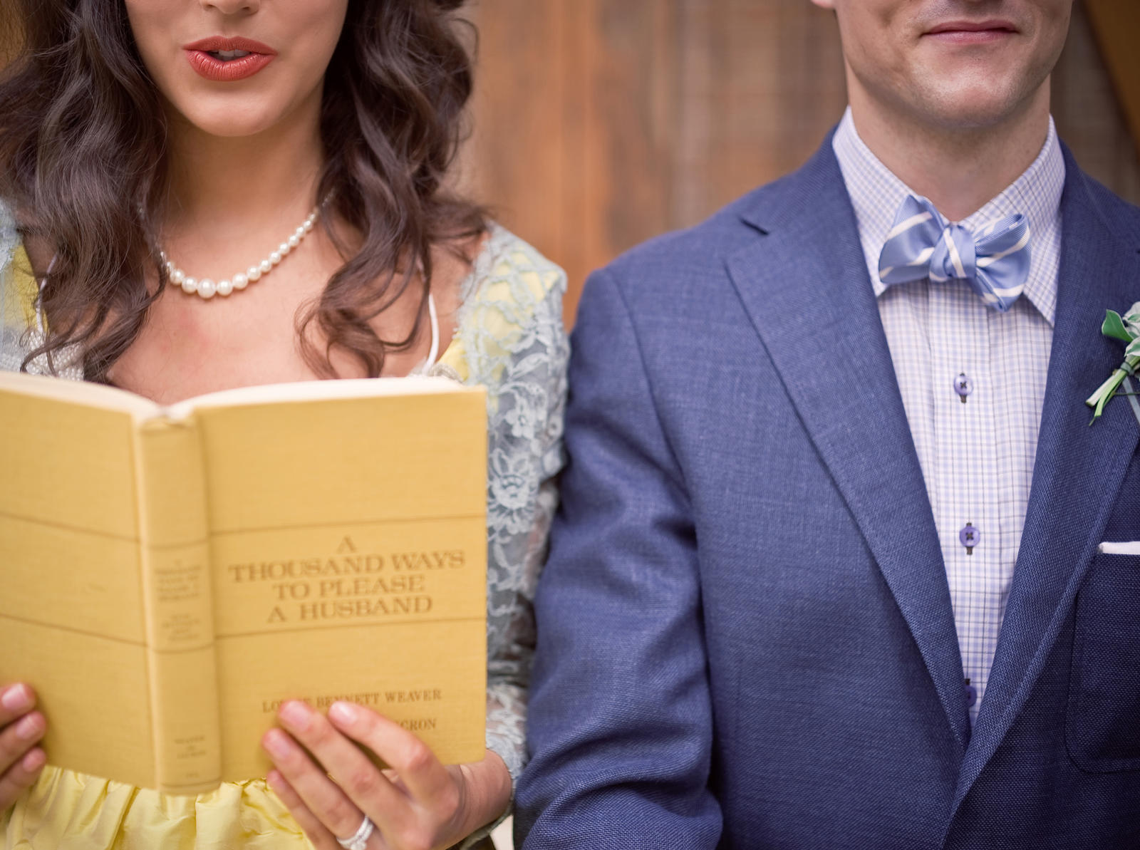 Lifestyle Photography | Atlanta, GA | A couple sit shoulder to shoulder. His outfit is blue, and hers is yellow.