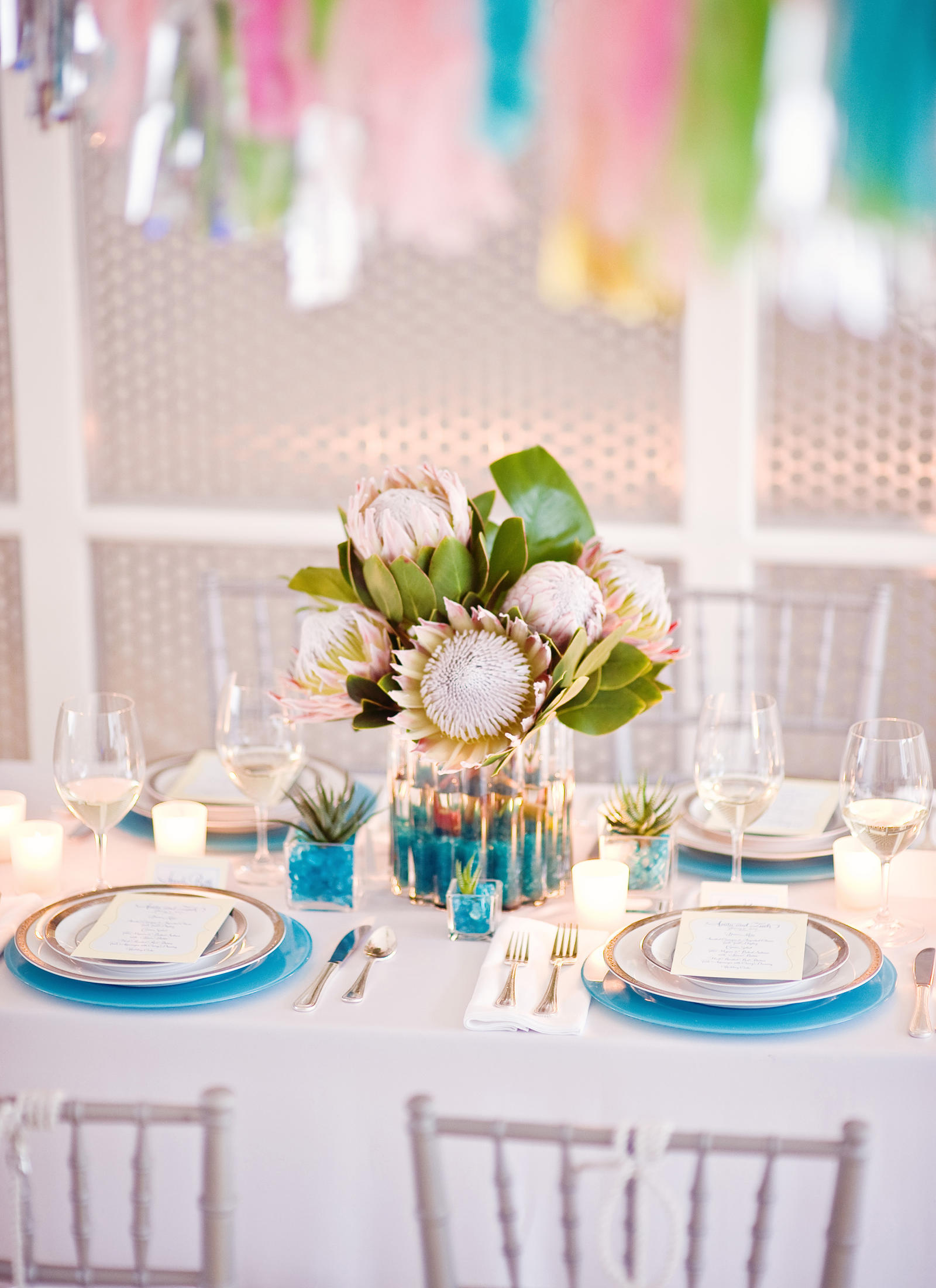 A table set with a tropical centerpiece.