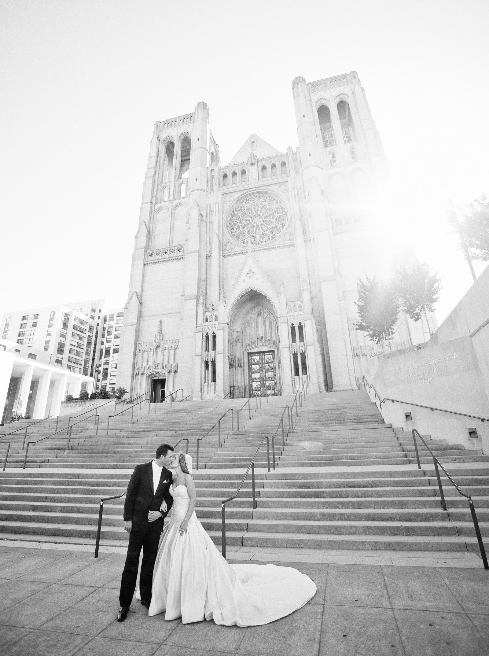 Wedding Photography | Bride and groom kissing in front of Grace Cathedral San Francisco, CA
