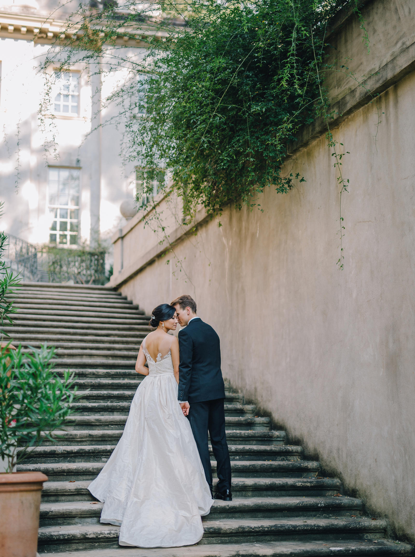 Wedding Photography | Bride and groom walking up stairs at Swan House Atlanta, GA