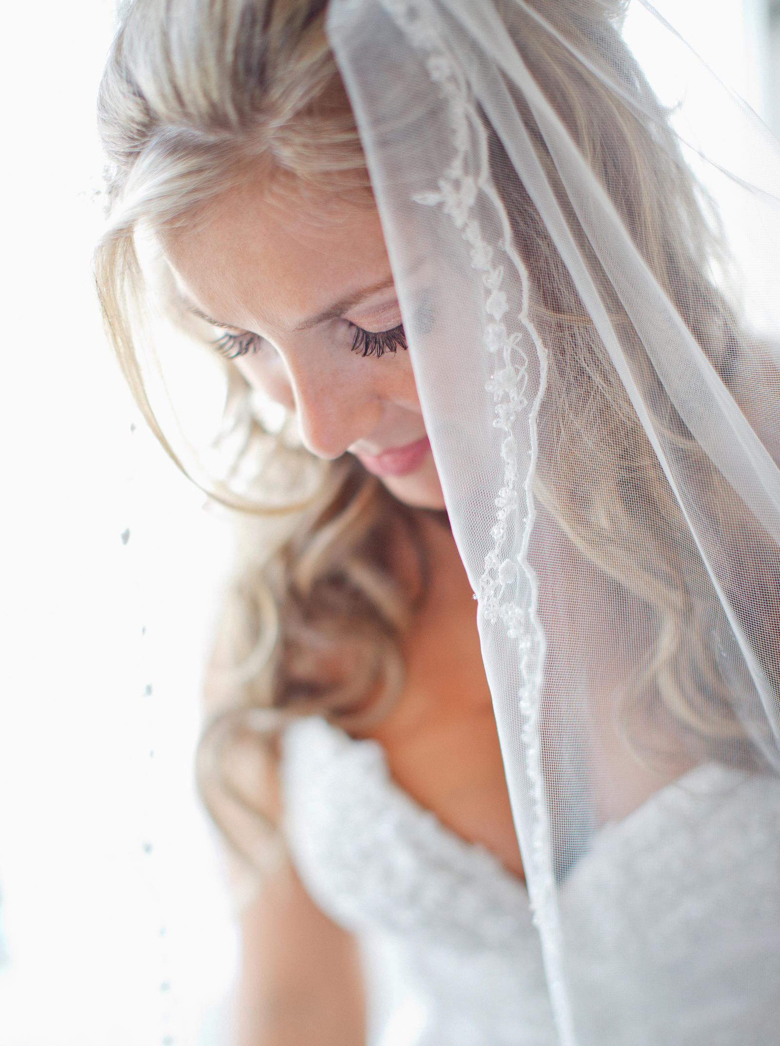 Wedding Photography | A closeup of a bride in her wedding dress.