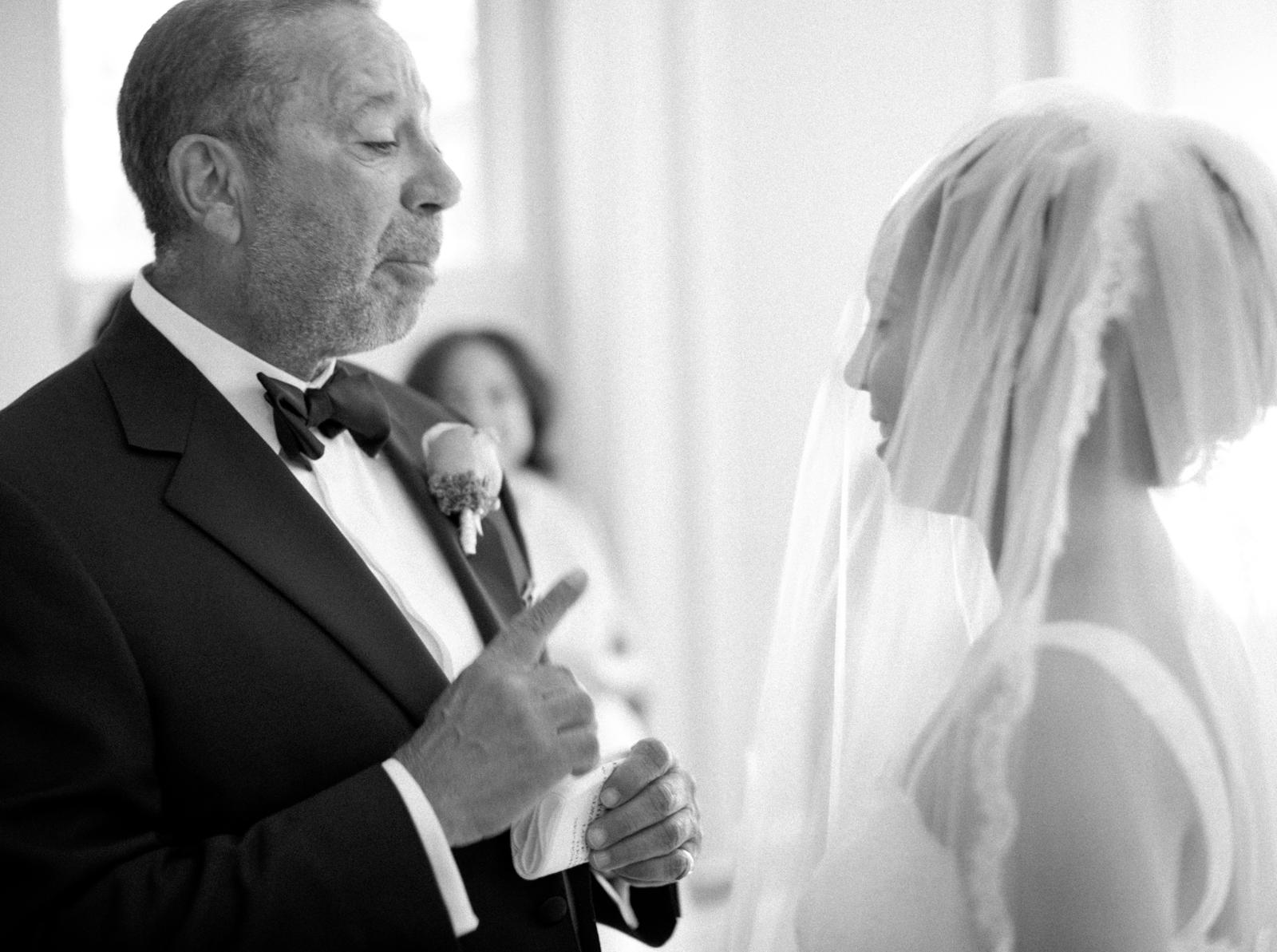 Wedding Photography | A bride and her father talk before the wedding.